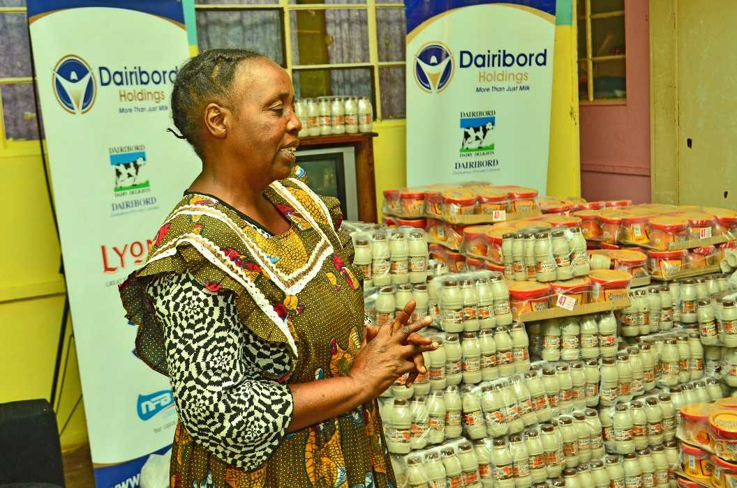 Matron for Chirinda orphanage in Mt Selinda Chipinge acknowledging receipt of products from Dairibord Holdings staff-compressed